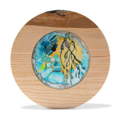Buy 'Rockpool I', a handmade lighted piece made from glass and wood by Helen Grierson. Image shows a circular piece of decorative glass, coloured with blue, yellow and black, set in a natural wood frame. The sculpture sits on a white background.
