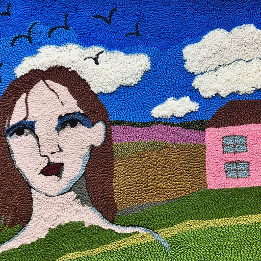 Buy 'I don't remember much but the outside was painted pink', a tapestry wall hanging by textile artist Selby Hurst Inglefield. Image shows a section of a tapestry landscape with a floating portrait of a brunette person to the left and a pink house to the right