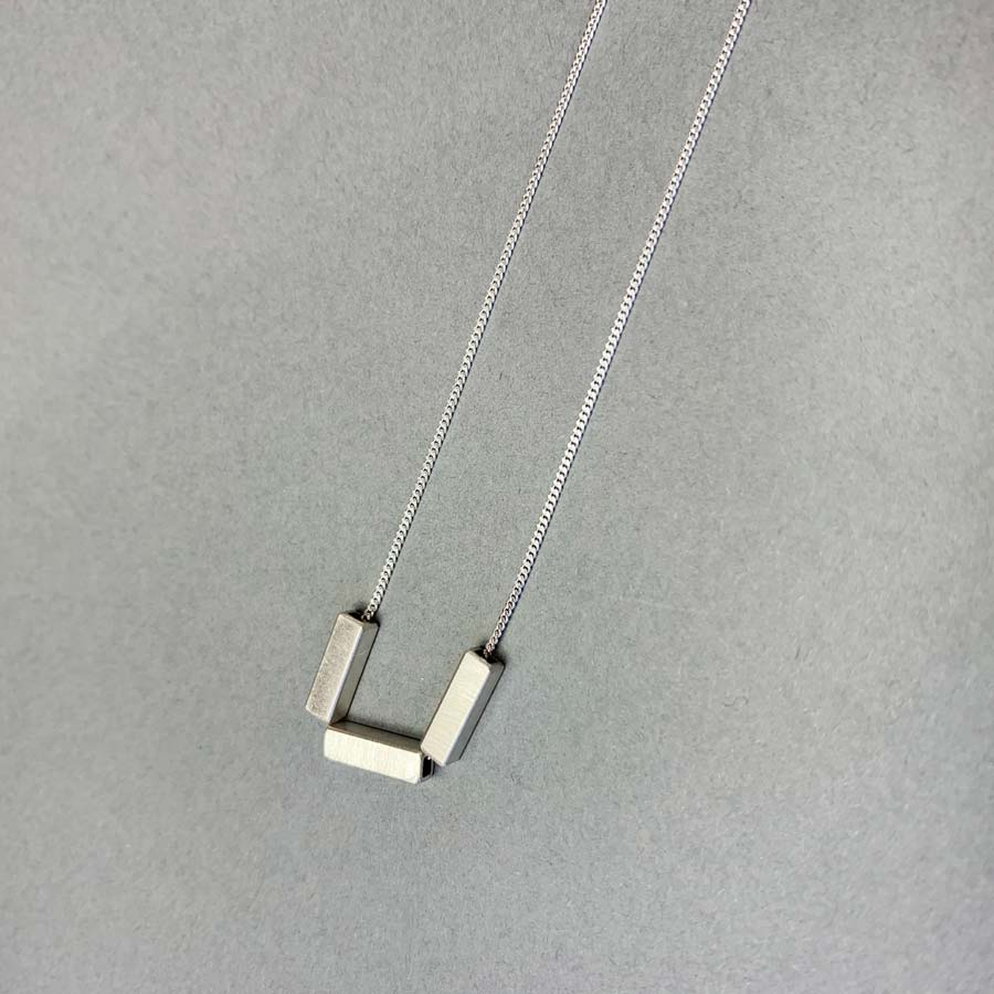 Buy '3 Tube Necklace' handmade jewellery by Chloe Solomon at The Biscuit Factory.