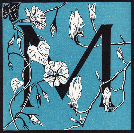 View and buy typography prints by Julie North at The Biscuit Factory. Image shows a blue square print with a black border featuring the letter M at the centre decorated by white flowers