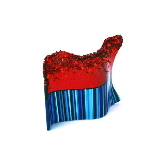 Buy 'Textured Blue and Red Sculpture', a handmade glass sculpture by Catherine Mahe. Image shows a wavy glass panel stood upright, the bottom half is made up of stripes in varying shades of blue and the top half is bright red which blends into texture that forms a granulated texture at the very top.
