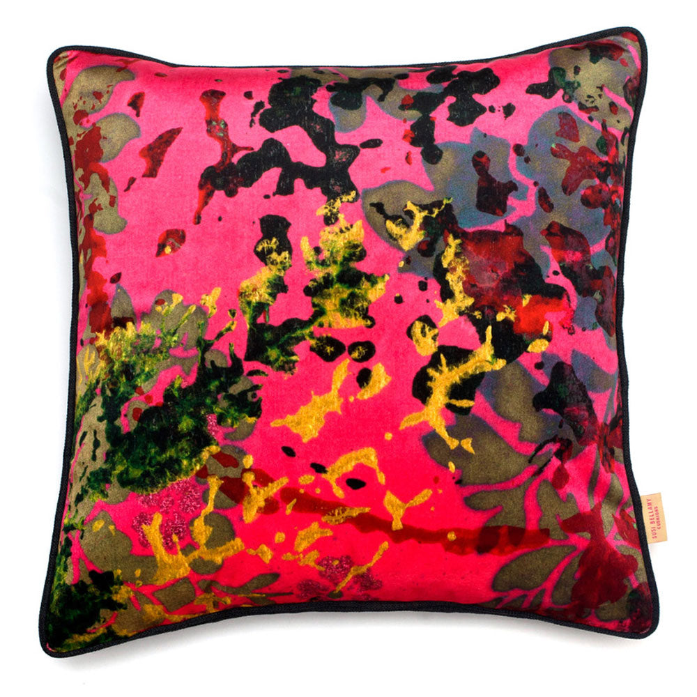 Buy original handmade cushions by textile artist Susi Bellamy. Image shows a velvet cushion featuring an abstract print of yellow, khaki, navy and black resembling foliage.