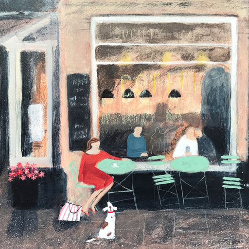 'Here for You', a landscape painting by Barbara Pierson. Image shows a painting of a cafe from the outside, teal table and chairs sit under a window which displays the customers inside. A woman in a red dress sits outside with a white and brown spotted dog turning to look at her.
