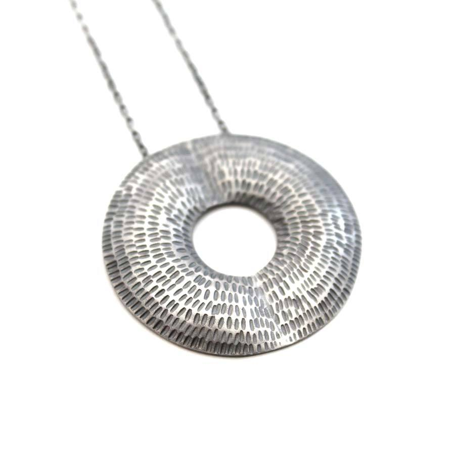 Buy 'Torus Pendant (Oxidised silver)' handmade jewellery by Caitlin Hegney at The Biscuit Factory, Newcastle upon Tyne.