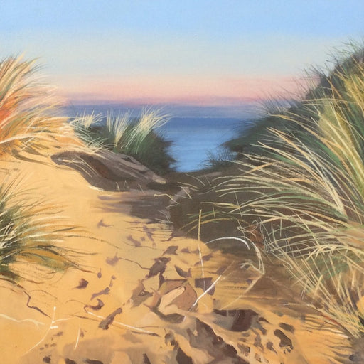 Buy 'Towards Twilight', a coastal landscape by Graham Rider at The Biscuit Factory. Image shows a painting of a path of footprints in the sand between grassy sand dunes. In the background is a blue and pink wash of the sea blurring into the sky.