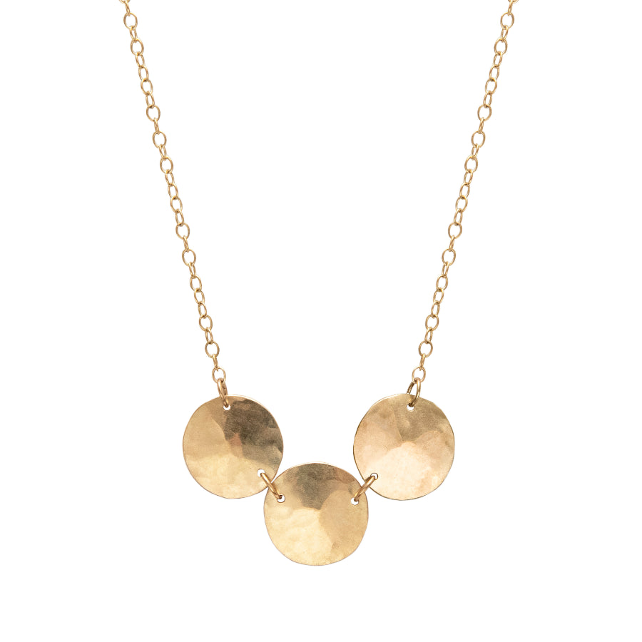 Buy 'Gold Triple Droplet Necklace' a recycled gold necklace by Sarah Ruth Stanford. Image shows a necklace on a white background. The necklace is made up of gold chain and 3 gold disc pendants subtly bevelled and chained together in a row.
