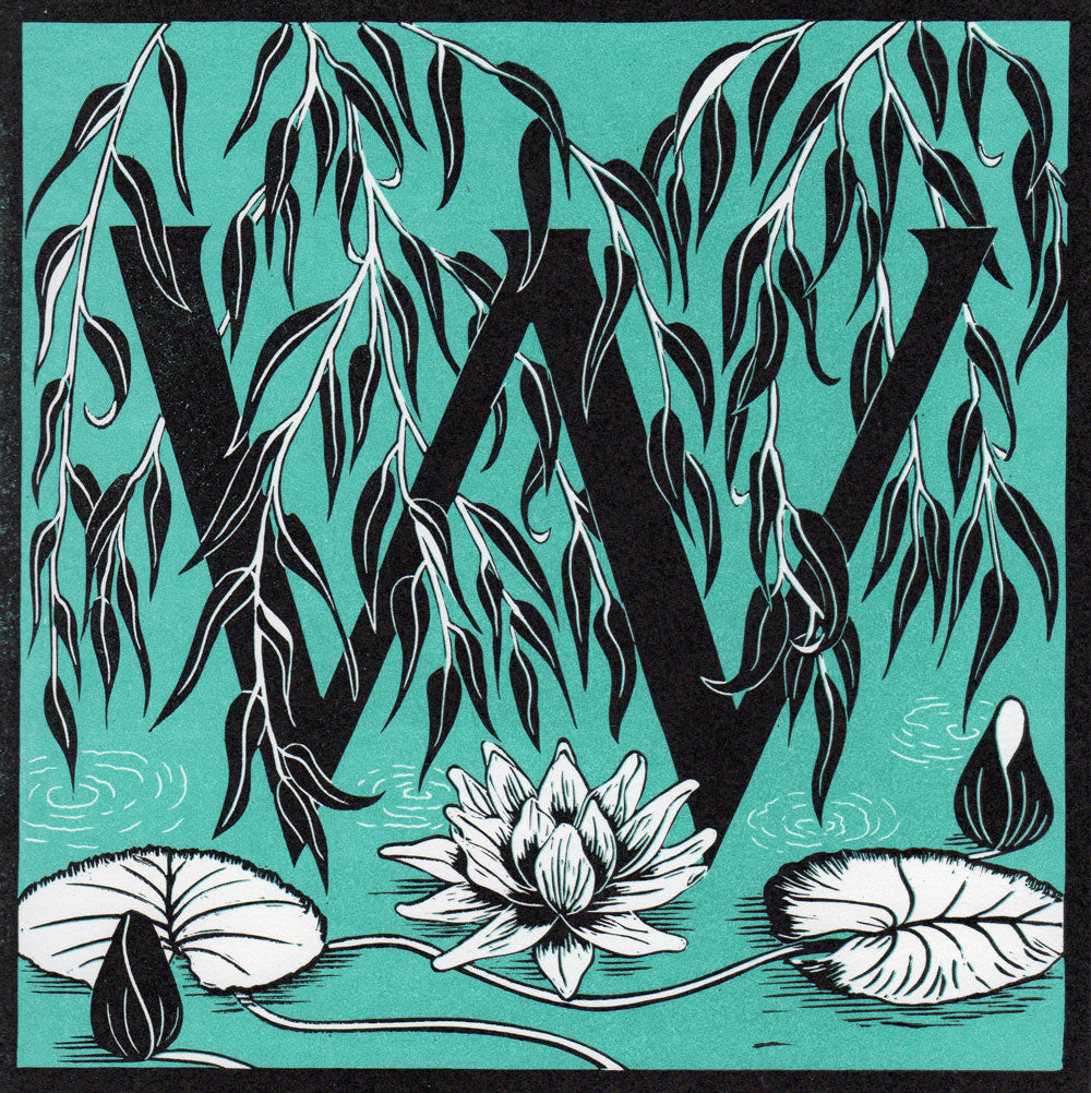 View and buy typography prints by Julie North at The Biscuit Factory. Image shows a light blue square print with a black border featuring a letter W at the centre surrounded by black willow leaves and a white water lily