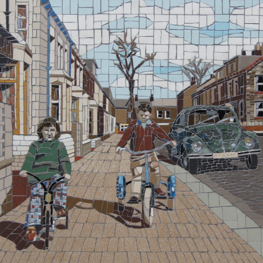 View and buy original artwork online at The Biscuit Factory. Part of the New Light Exhibition 2020: 'Leon and I' a mosaic by Ruth Wilkinson Image shows a mosaic of two children riding bikes down a terraced street, to the right is an old green beetle car.
