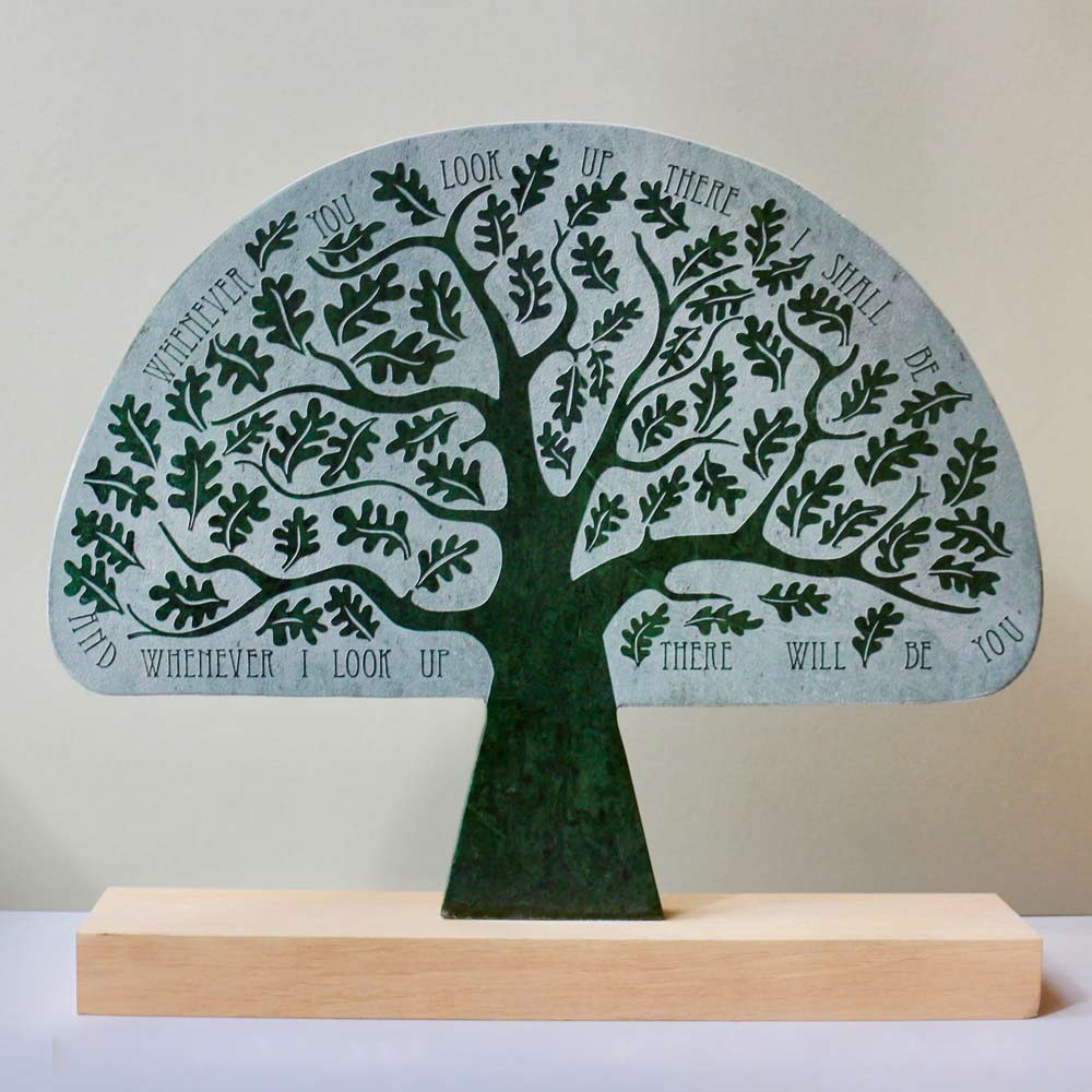 Buy 'Gabriel Oak Tree', a marble sculpture by Michael Disley. Image shows a semi-circular paddle shaped sculpture in a light green decorated with a emerald green tree. around the edges in an inscription reading Whenever You look up there I shall be and whenever I look up there will be you'.
