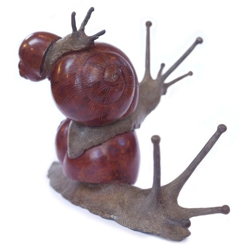 Buy 'Daytripper' a limited edition bronze sculpture by Mark Hall. Image shows a bronze sculpture of three snails stacked one on top of another, arranged in size order with the largest on the bottom and the smallest on the top. The body of the snail is textured and matte brown whereas the shell is a polished mahogany colour. The background is white