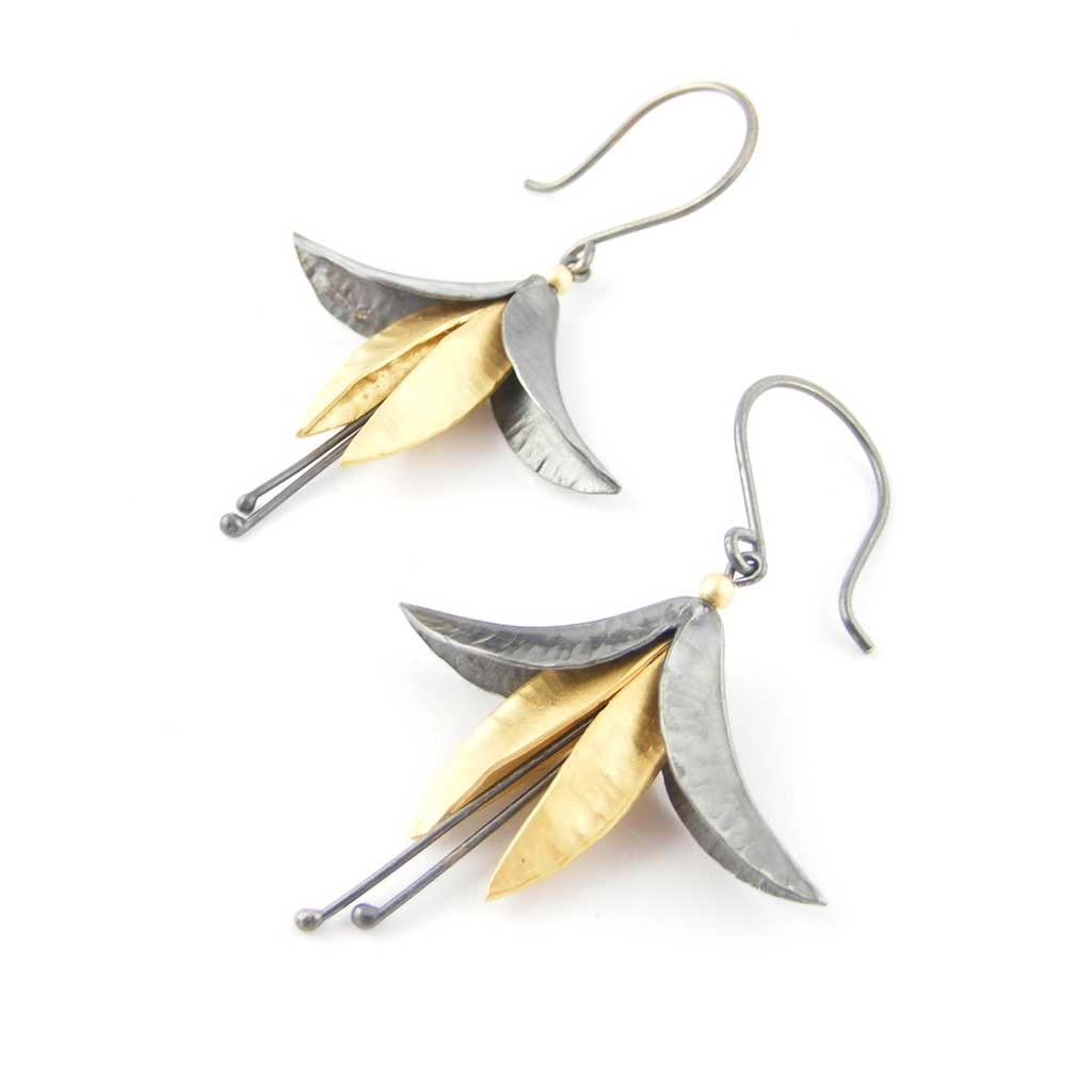Buy 'Oxidised Silver and Gold Fuchsia Earrings', mixed metal flower earrings by jeweller Nettie Birch. Image shows a a pair of oxidised silver and gold fuchsia flower earrings hanging from oxidised hooks. The earrings sit on a white background.