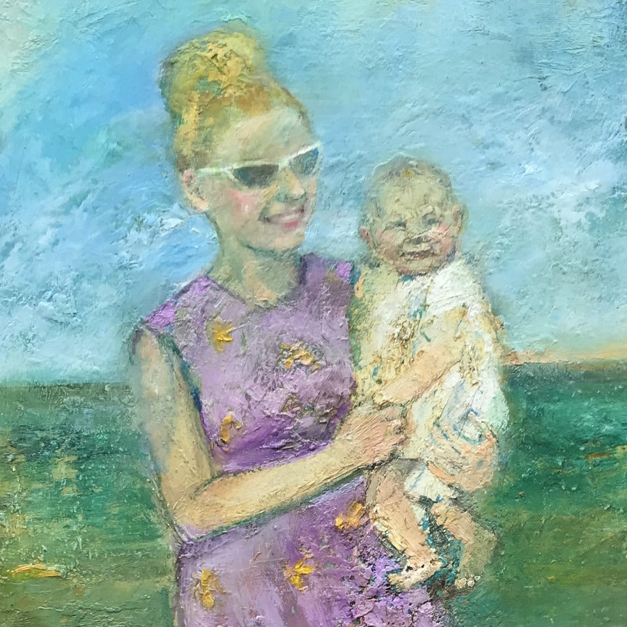 Buy 'Mother and Baby Paddling', a coastal scene oil painting by Rhonda Smith. Image shows a textured oil painting of a smiling woman with yellow hair in a pink floral dress and white sunglasses holding a baby in white on her hip while paddling in the green sea.