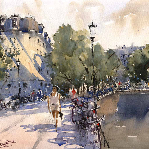 Buy 'Lady in Hat', a framed watercolour painting by Alan Smith Page. Image shows a busy street in Amsterdamn with a large building to the left an a canal to the right with a bridge in the background. Bikes can be sen lining the fence and a woman in white walks down the center of the street