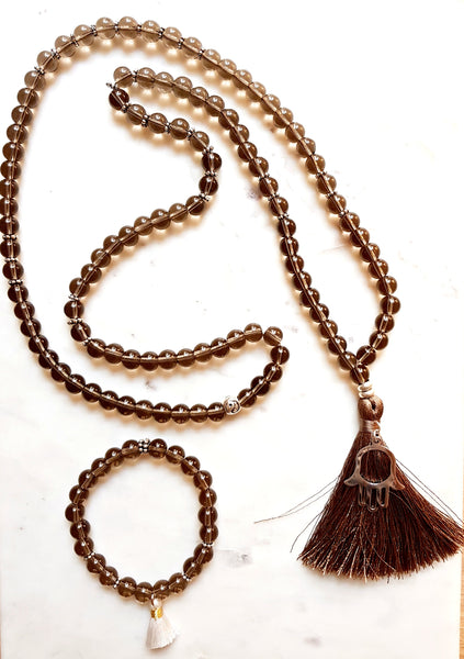 Aria Mala Atelier's unique one-of-a-kind brown smoky quartz gemstone meditation japa mala with silver Hamsa charm is for yoga meditation spiritual daily practise and intention setting