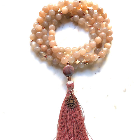 Aria Mala Atelier's unique one-of-a-kind Sunstone, Carnelian Agate gemstone mala with silver mandala charm is for yoga meditation empowering spiritual daily practise and intention setting