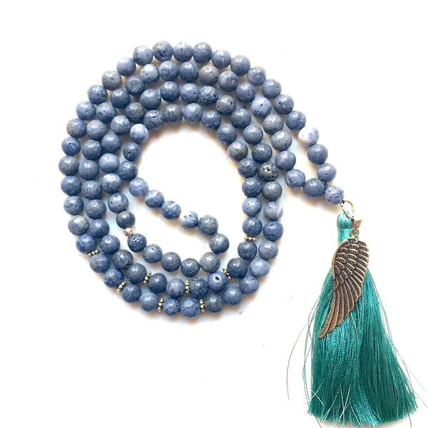 Aria Mala Atelier's unique one-of-a-kind blue coral gemstone meditation japa mala with angel wing silver charm is for yoga meditation empowering spiritual daily practise and intention setting