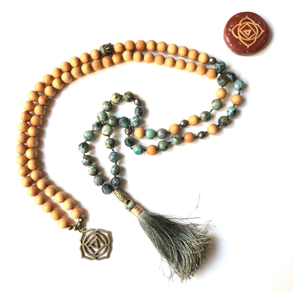 Aria Mala Atelier's unique one-of-a-kind African turquoise gemstone meditation japa mala with first (root) chakra charm is for yoga meditation empowering spiritual daily practise and intention setting