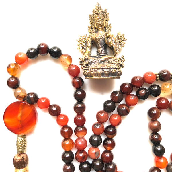 Aria Mala Atelier's unique one-of-a-kind brown agate gemstone meditation japa mala with copper buddha charm is for yoga meditation empowering spiritual daily practise intention setting and mindfulness practices