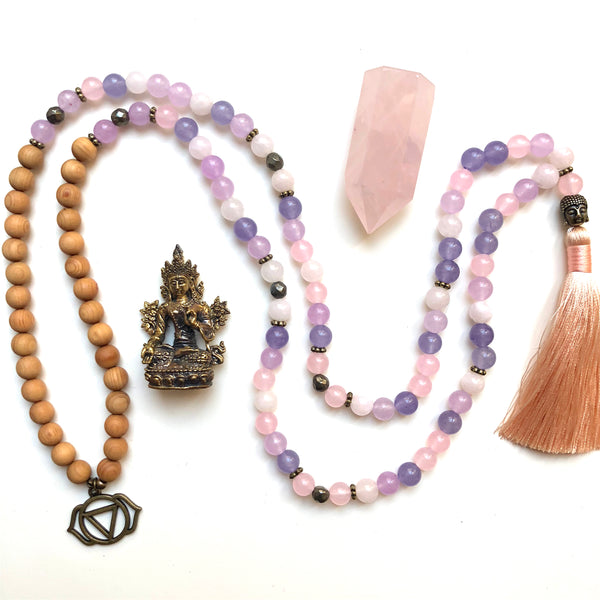 Aria Mala Atelier's unique one-of-a-kind lavender, rose jade, pyrite and sandalwood gemstone meditation japa mala with third eye chakra and buddha symbol charm is for yoga meditation empowering spiritual, mindfulness daily practise, intention setting