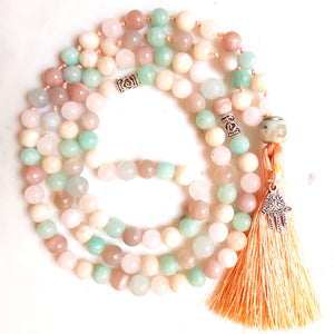Aria Mala Atelier's unique one-of-a-kind blue turquoise pink amazonite aquamarine sunstone jade gemstone meditation japa mala with silver Hamsa charm is for yoga meditation empowering spiritual daily practise and intention setting
