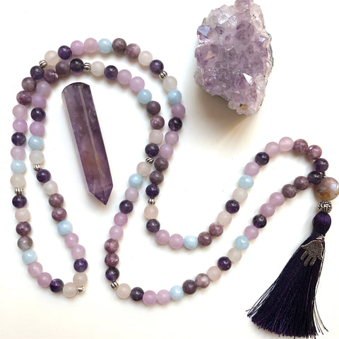 Aria Mala Atelier's unique one-of-a-kind Aquamarine, Quartz, Amethyst, Lepidolite, Jade gemstone meditation japa mala with silver hamsa charm is for yoga meditation empowering spiritual, mindfulness daily practise and intention setting