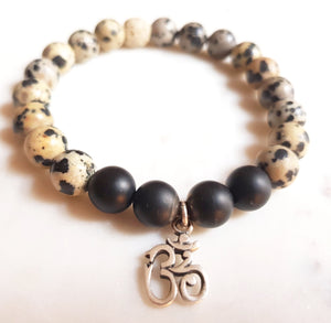 Aria Mala Atelier's unique one-of-a-kind Onyx, lavastone yoga bracelet with sterling silver OM charm for spiritual living