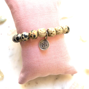 Aria Mala Atelier's unique one-of-a-kind Jasper and White Lava stone with OM charm for spiritual living