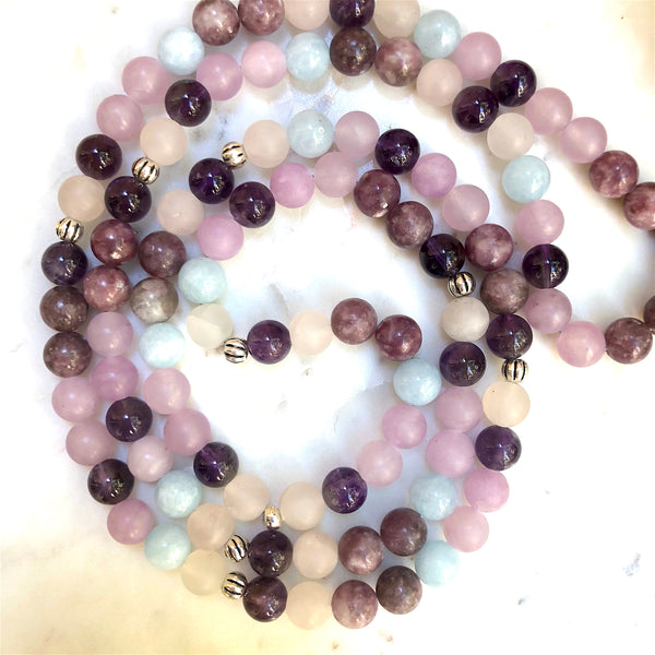 Aria Mala Atelier's unique one-of-a-kind Aquamarine, Quartz, Amethyst, Lepidolite, Jade gemstone meditation japa mala with silver mandala charm is for yoga meditation empowering spiritual daily practise and intention setting