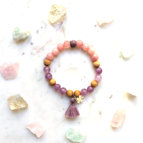 Aria Mala Atelier's unique one-of-a-kind Mat Rose & Lilac Jade, Natural Sandalwood yoga bracelet with sterling silver clover charm and mini lilac tassel for spiritual living