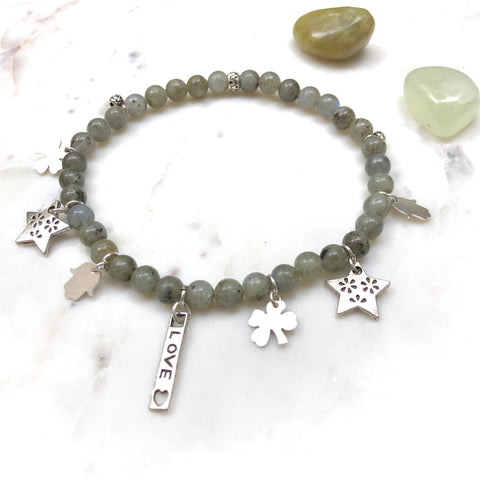 Aria Mala Atelier's unique one-of-a-kind Labradorite, Hamsa, Clover, Star, Love symbol charms for spiritual living and mindfulness practices