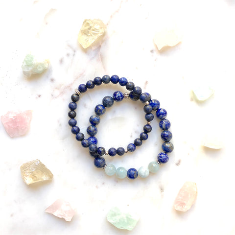 Aria Mala Atelier's unique one-of-a-kind Lapis Lazuli, Aquamarine silver charm yoga bracelet for spiritual living