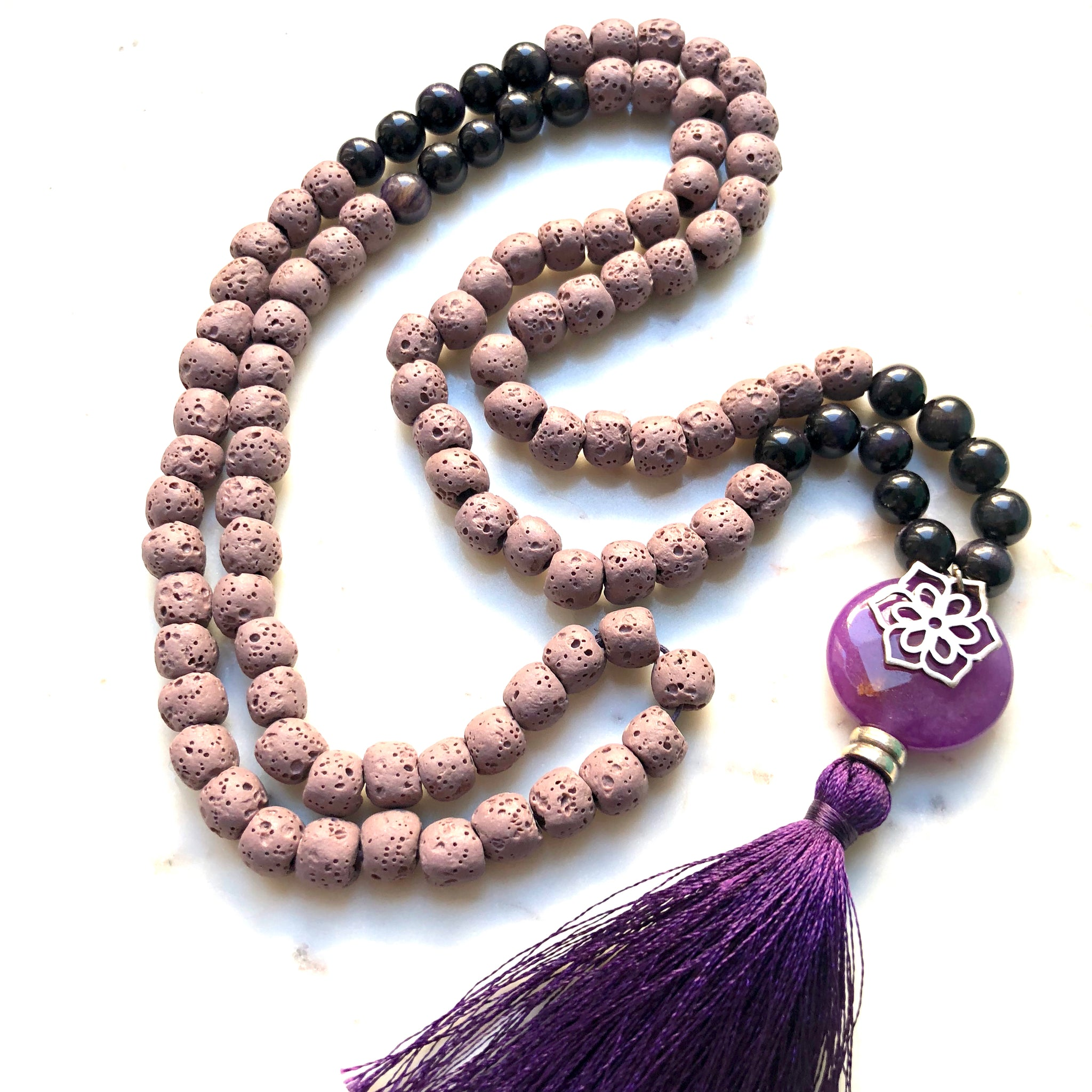 Aria Mala Atelier's unique one-of-a-kind lilac lavastone, purple jade gemstone meditation japa mala with silver mandala charm is for yoga meditation empowering spiritual daily practise and intention setting
