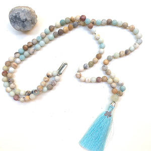 Aria Mala Atelier's unique one-of-a-kind mat natural amazonite meditation japa mala with clover and namaste silver charm is for yoga meditation empowering spiritual daily practise and intention setting, mindfulness practices