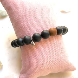Aria Mala Atelier's unique one-of-a-kind Black Onyx with Buddha Charm (antique bronze) yoga bracelet charm for spiritual living