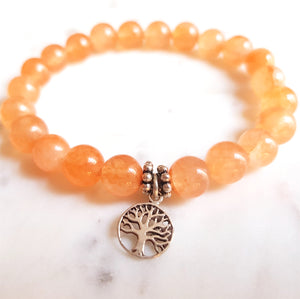 Aria Mala Atelier's unique one-of-a-kind salmon jade yoga bracelet with sterling silver Tree of life charm for spiritual living