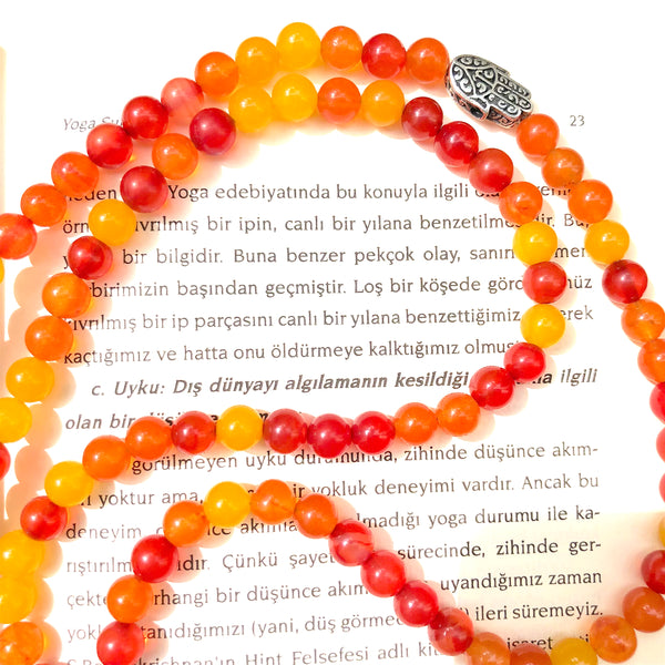 Aria Mala Atelier's unique one-of-a-kind sun color agate gemstone meditation japa mala with silver hamsa charm is for yoga meditation empowering spiritual, mindfulness daily practise, intention setting