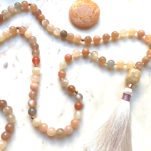 Aria Mala Atelier's unique one-of-a-kind feminine power Peach Moonstone gemstone meditation japa mala with rose color sterling silver charm is for yoga meditation empowering spiritual daily practise and intention setting