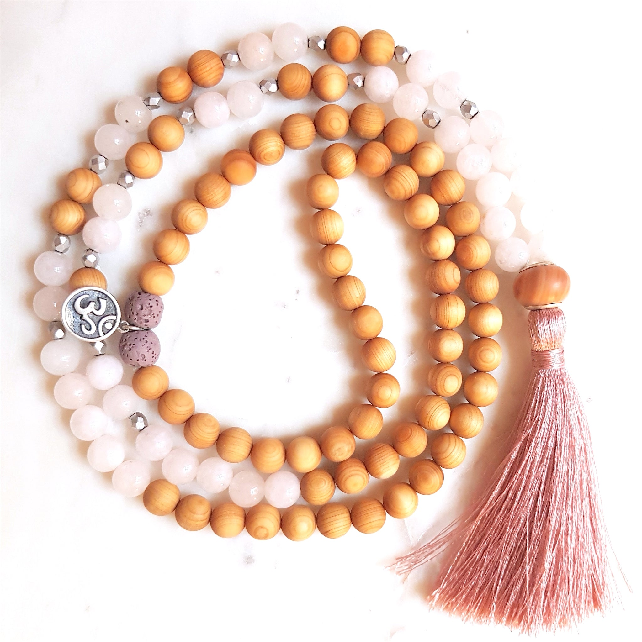 Aria Mala Atelier's unique one-of-a-kind sandal wood pink jade gemstone meditation japa mala with silver OM charm is for yoga meditation empowering spiritual daily practise and intention setting