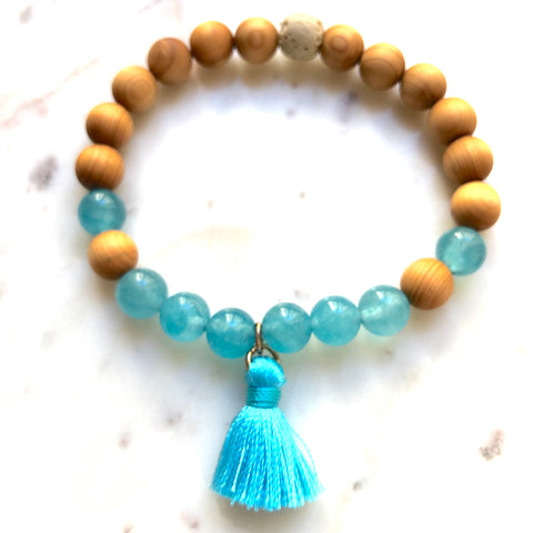 Aria Mala Atelier's unique one-of-a-kind Turquoise Jade, Natural Sandalwood yoga bracelet with cotton mini tassel for spiritual living
