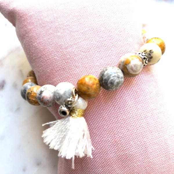 Aria Mala Atelier's unique one-of-a-kind sky eye jasper bracelet with cotton tassel for spiritual living