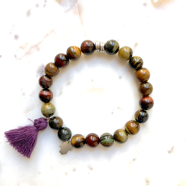 Aria Mala Atelier's unique one-of-a-kind Tiger's eye yoga bracelet with sterling silver Hamsa (Fatima's Hand) charm for spiritual living