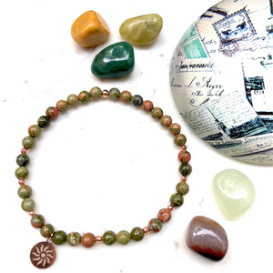 Aria Mala Atelier's unique one-of-a-kind unakite sun symbol charm for spiritual living and mindfulness practices