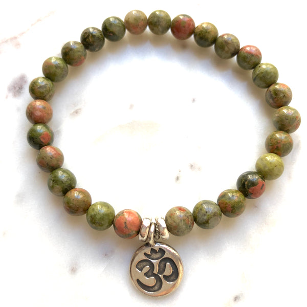 Aria Mala Atelier's unique one-of-a-kind Unakite yoga bracelet with OM charm for spiritual living