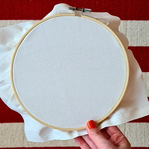 Photo of an embroidery hoop being held in hands
