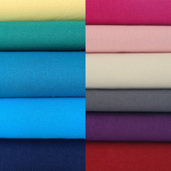 Photo of a stack of different types of fabric