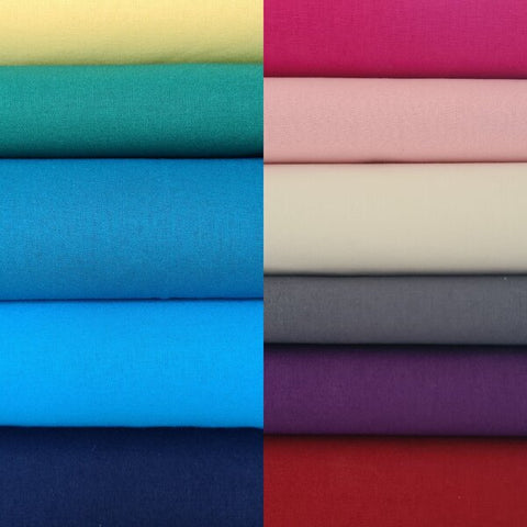 Photo showing a pile of different types of fabrics