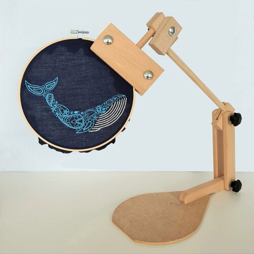 Photo of an embroidery hoop stand holding a hoop