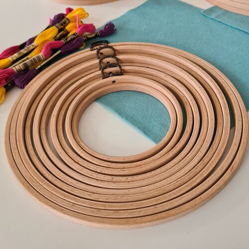 photo of multiple embroidery hoops of different sizes