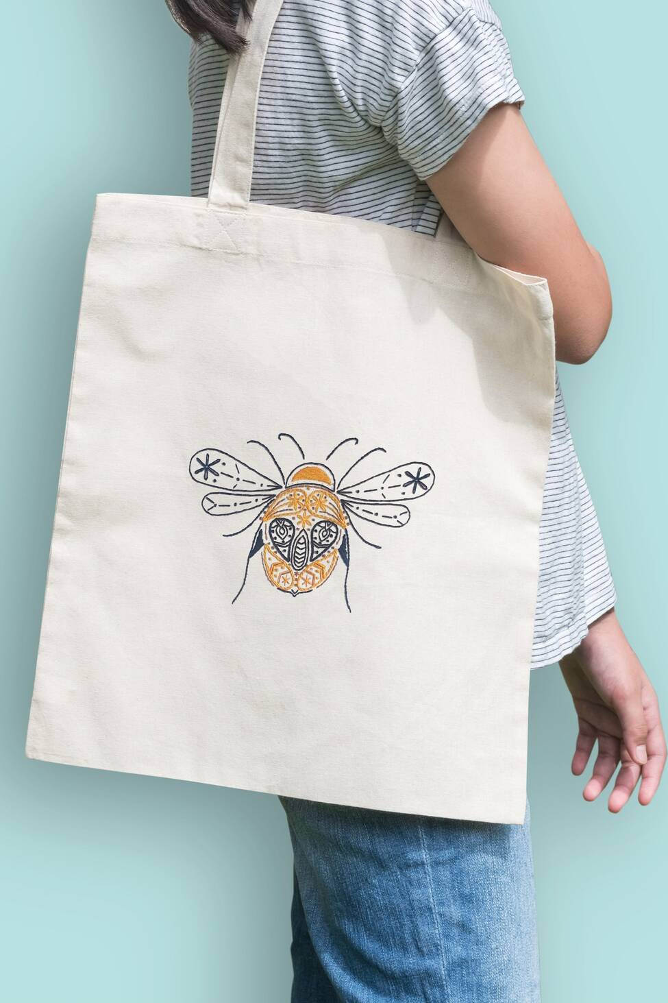 Organic and fairtrade tote bag with bee pattern embroidered on it