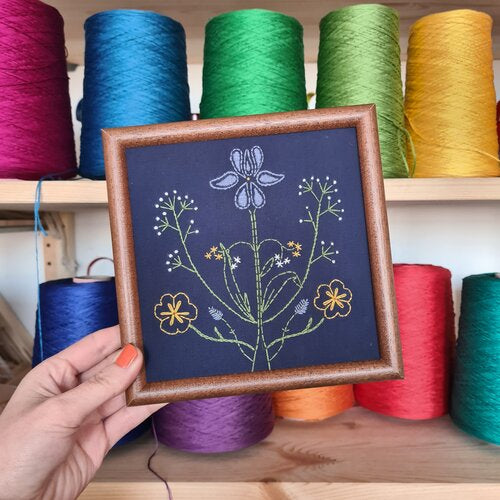 A paraffle embroidery botanicals design framed in a picture frame